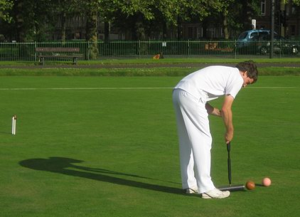 James Hopgood in play on Saturday evening. (Photograph taken just after impact in the croquet stroke, with brown off the ground)