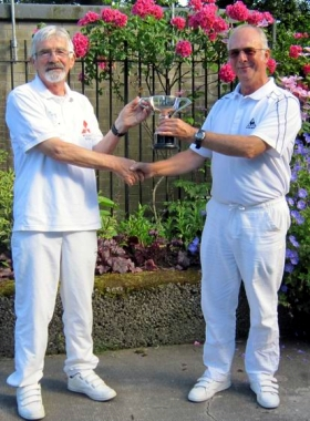 Jamieson Walker (left) receiving the cup from the manager