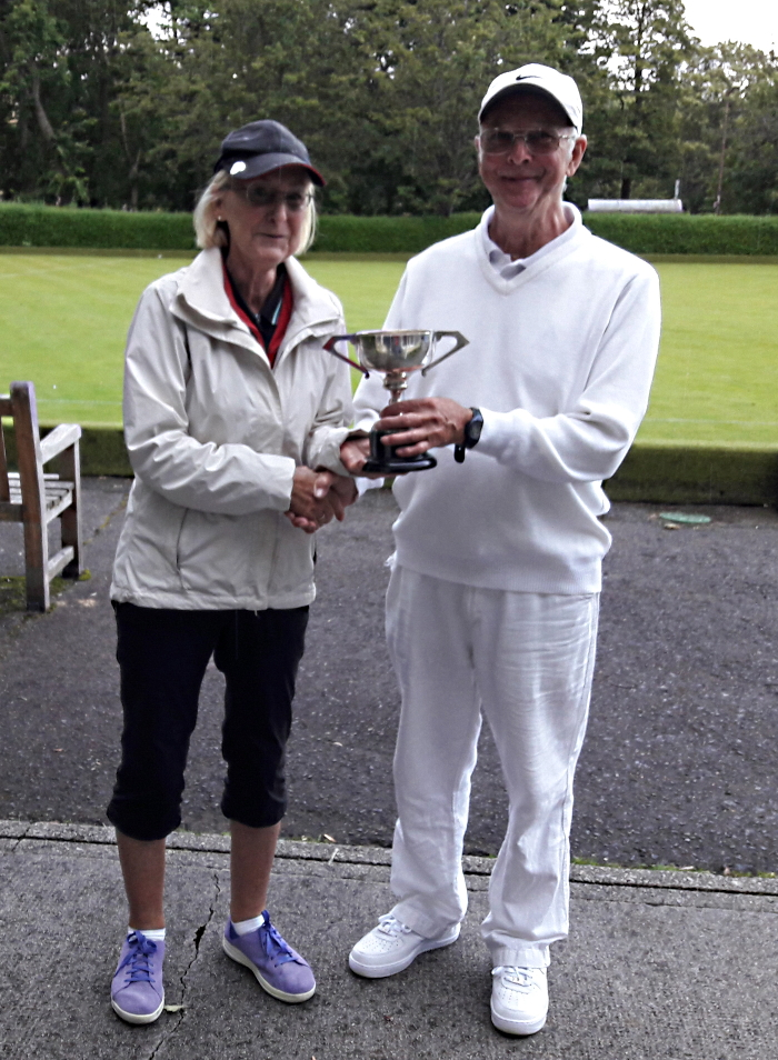 Janice Duguid presenting the cup to Hamish Duguid